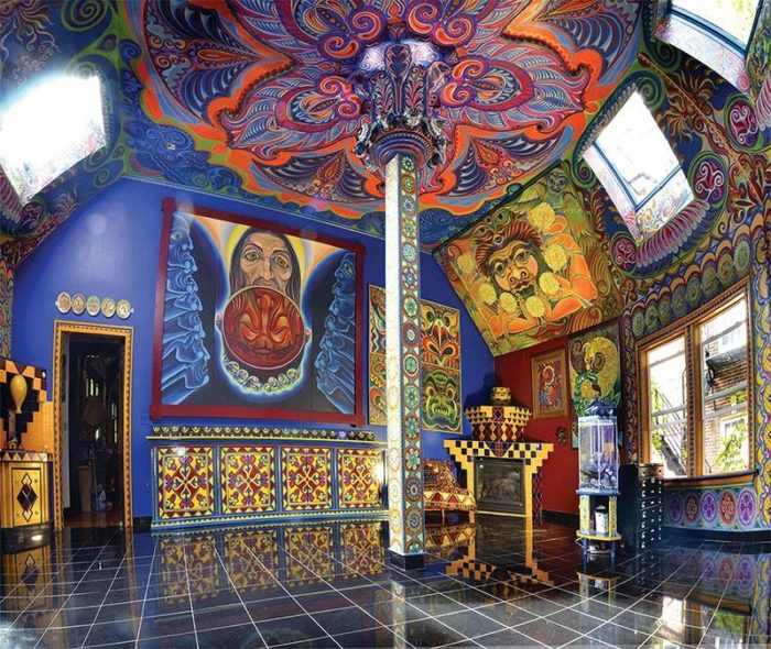 Throughout the home, fairytale landscapes and mythological creatures cover almost every inch of exposed wall.