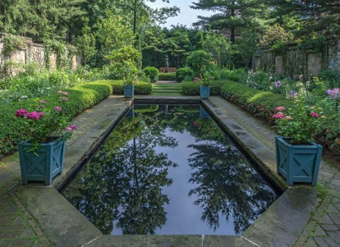 The 65-room estate features five historic buildings, eight gardens and 70 acres total.