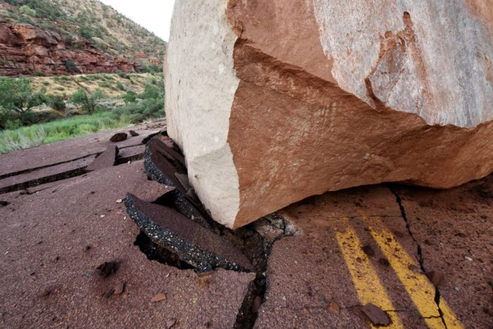 When this humongous rock tumbled down the mountain onto the road, it clearly did some damage.