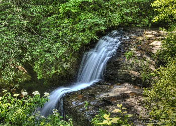 3. Hiking through nature, observing the waterfalls.