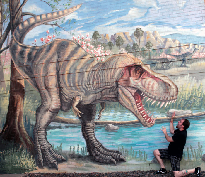 """""""So what's caught T-Rex's attention? Why, it's you! Please 'feed' yourself to the T-Rex, and take a picture or two."""""""