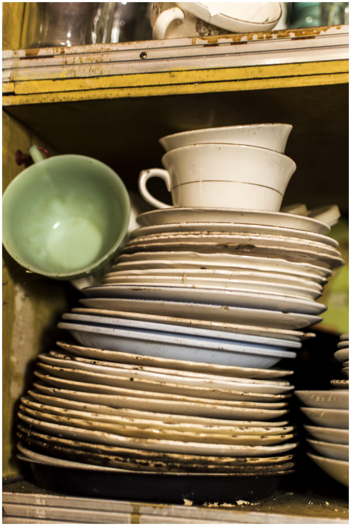 Even the dishes and silverware are still piled neatly in their proper places.
