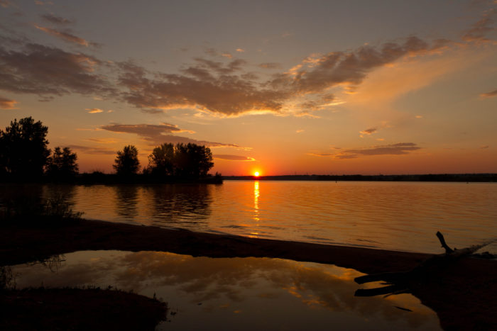 18. Enjoy the tranquil dawning of the day at a nearby lake or reservoir.