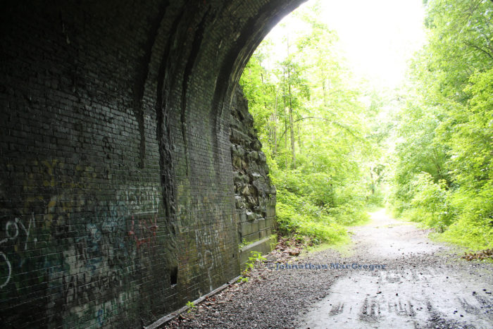 In 1856, the railroad was the only route to Moonville. Throughout the years, many people have died near the tunnel and train tracks. Because the tunnel was so narrow, it was not possible for pedestrians to walk alongside the tracks in the tunnel while a train was passing through—which resulted in numerous deaths.
