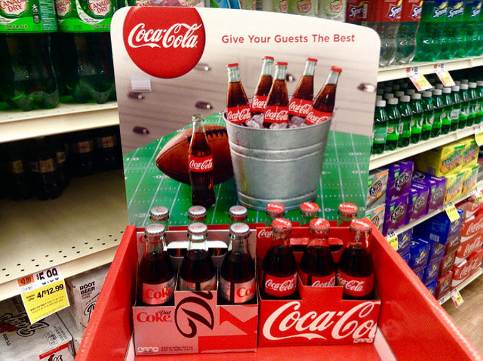 5. A tax of 1 cent is levied for every 16 and 9 ounce containers of coke sold in a store.