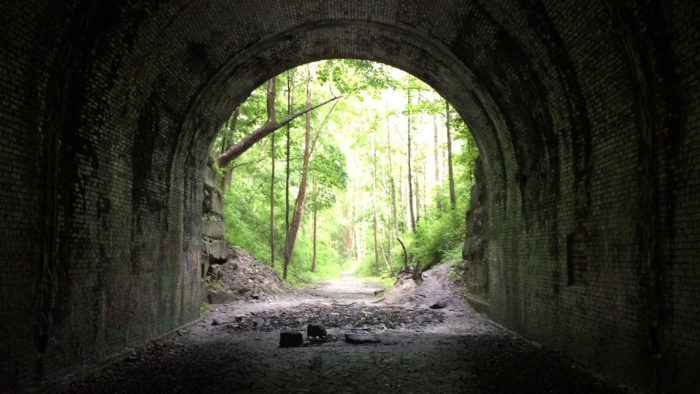 One structure of the town that remains today is the Moonville Tunnel, a haunted tunnel where legend has it the ghost of a man who was killed instantly by a train passing through the tunnel wanders along the track bed near the old tunnel at night.