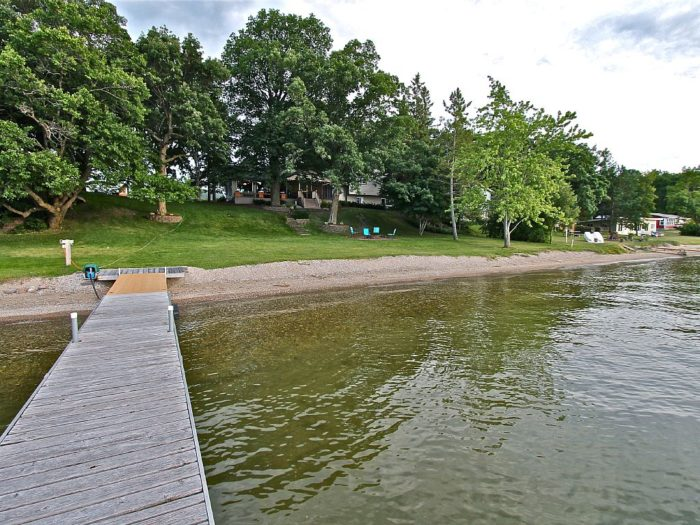 6. This stunning property on Jewett Lake near Fergus Falls sleeps 10, and has the perfect lawn and patio for games and campfires! Learn more or rent it here.