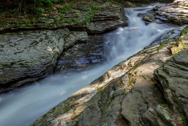 2. Zip down a natural water slide.