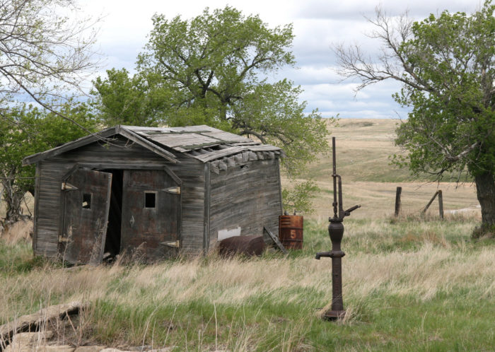 3. A decaying building and a water pump still stand in Temvik, North Dakota. This town had many names over its life - Godkin, Brophy, and Union City - but today it is barely remembered by any name.