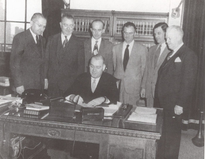 9. Signing that bill that made University of Rhode Island a university, 1951.