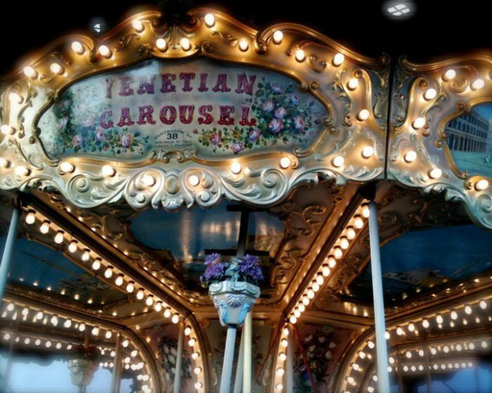 The vintage carousel was hand-painted in Treviso, Italy.