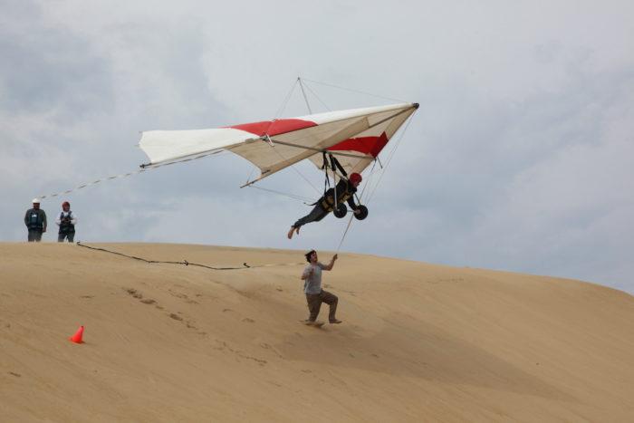 2. Hang glide off the tallest active sand dune on the east coast, Jockey's Ridge.