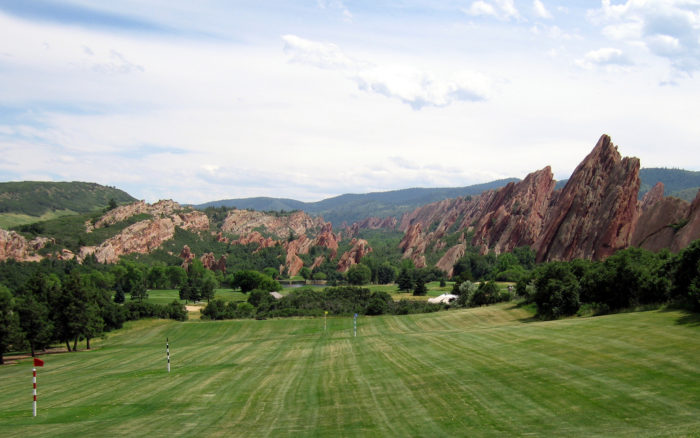 You expect to see lush, manicured greens at a golf course...but do you expect to see these stunning rock formations in the background?