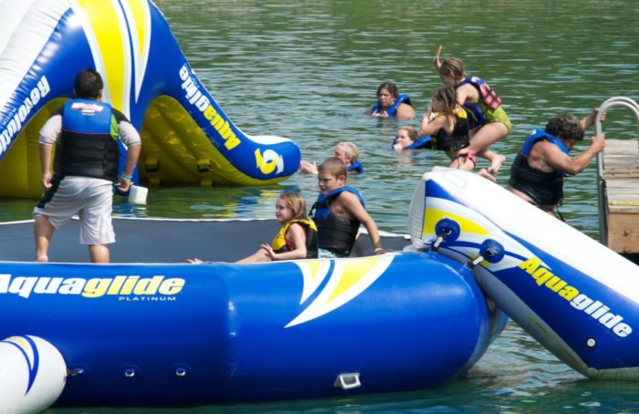 The lake has inflatables for bouncing and climbing.