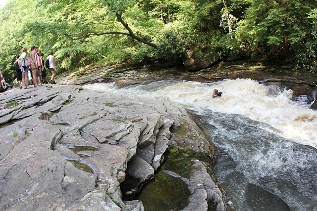 The popular natural waterslide is the result of cracks in the rocks, which left the rocks smooth.