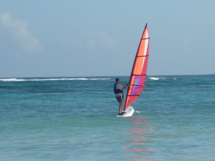 Go windsurfing in the crystal clear water or...