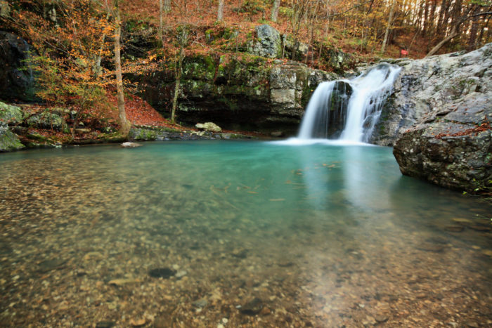 A stroll around the shores of Lake Catherine will lead you to Falls Creek Falls.