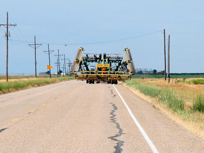 2. You've gotten stuck behind some sort of farming equipment on the road.