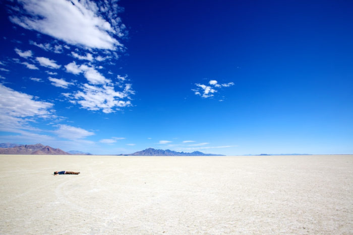 The wide-open skies contrast beautifully with the endless stretch of hard-packed salt flats.