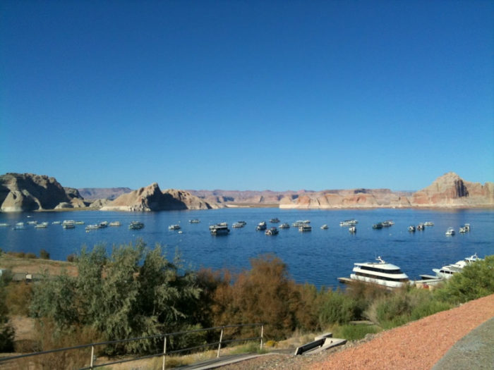Lake Powell is perfect for summer recreation. Of course, you can hang out on a houseboat.