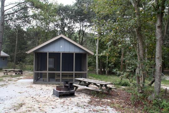 You can rent one of the cabins within the park...