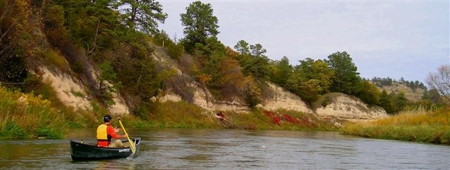 6. Hit the river in a canoe, kayak, tube, or tank.