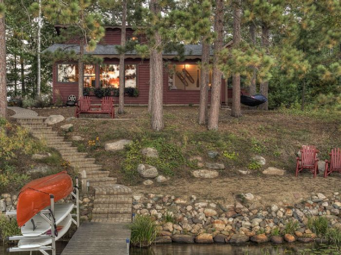 4. This stunning cabin on Lake O'Brien sleeps 6 and provides the quintessential MN experience! See photos of the gorgeous patio and rent it here.