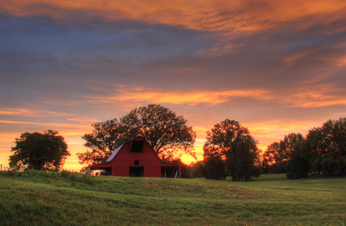 10. A lonely barn and a sky on fire.