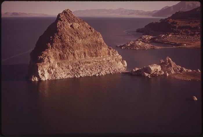 A large pyramid-shaped tufa rock