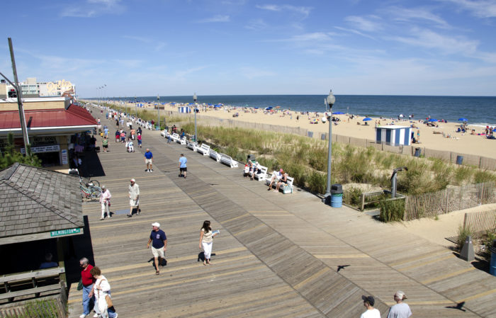 You can stroll along the gorgeous Rehoboth Beach Boardwalk while you're waiting for dark!