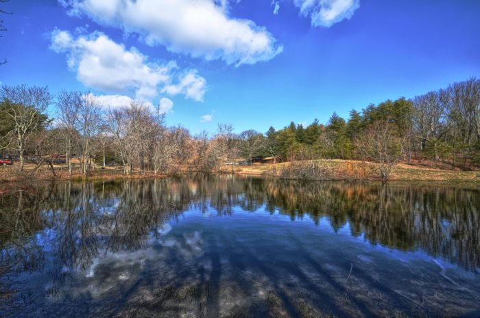 """Soon you'll approach a """"mirrored"""" lake, with crystal clear reflections of the sky and surroundings."""
