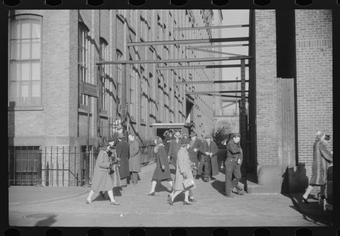 11. This image shows workers leaving a mill for the day in Providence.