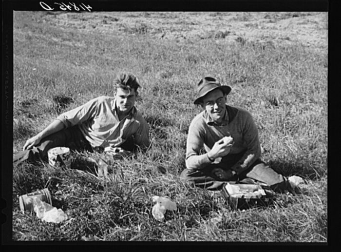 3. Two Caribou boys working on a farm near town. The one on the left is a foreman - most ate lunch in the fields.