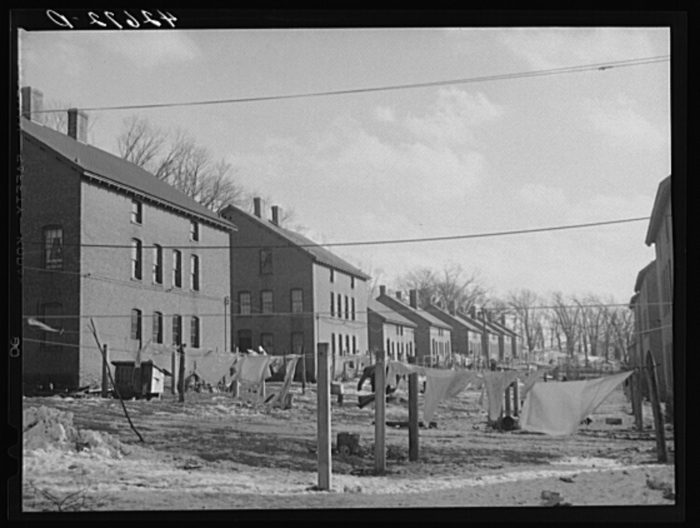 5. Rows of houses belonging to mill workers appear here in this image.