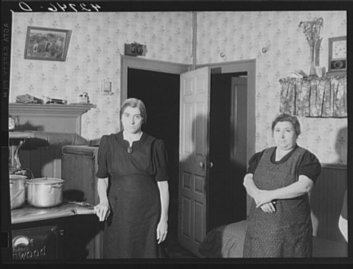 14. A pair of sisters who ran a truck farm during the 1930s are captured in this image.