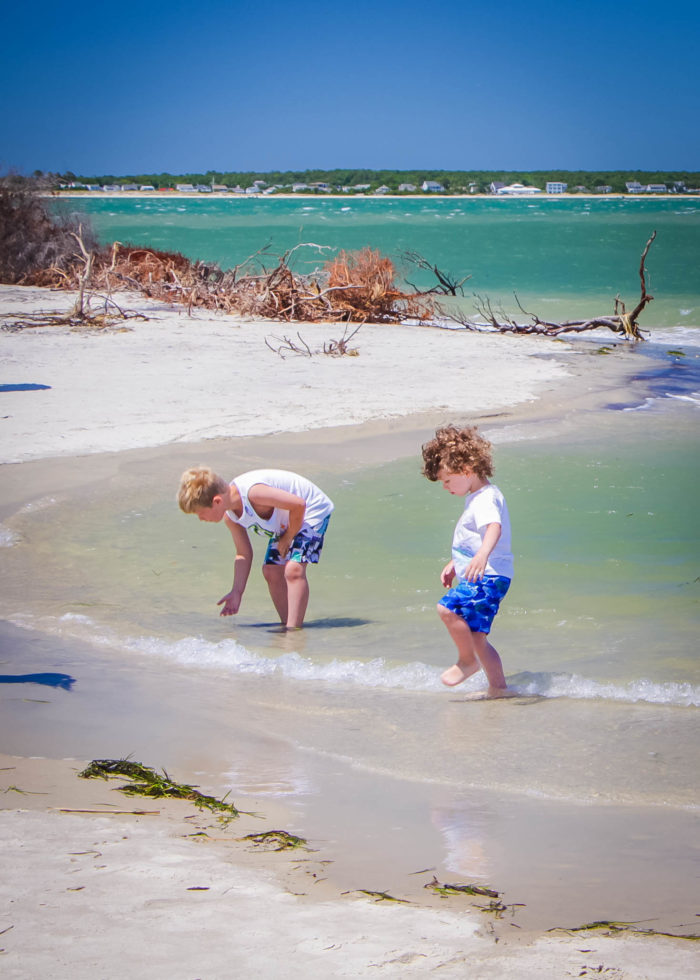 Children playing in clear water on the sound side of Shackleford