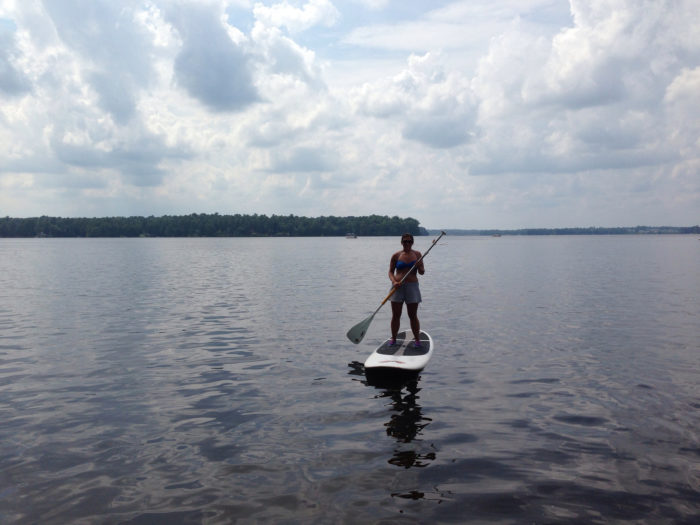 5. Try out paddle boarding.