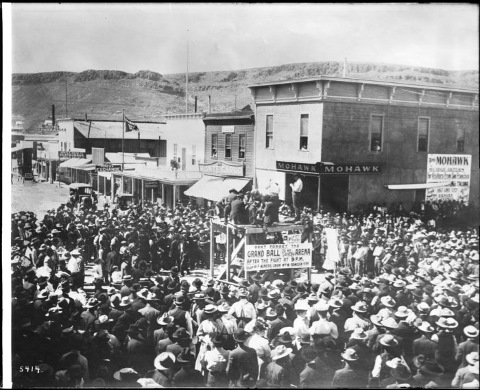 A_street_scene_of_people_boosting_for_tickets_to_the_-Grand_Ball-_during_the_boom_days_at_the_mines,_Goldfield,_Nevada,_ca.1905_(CHS-5414)