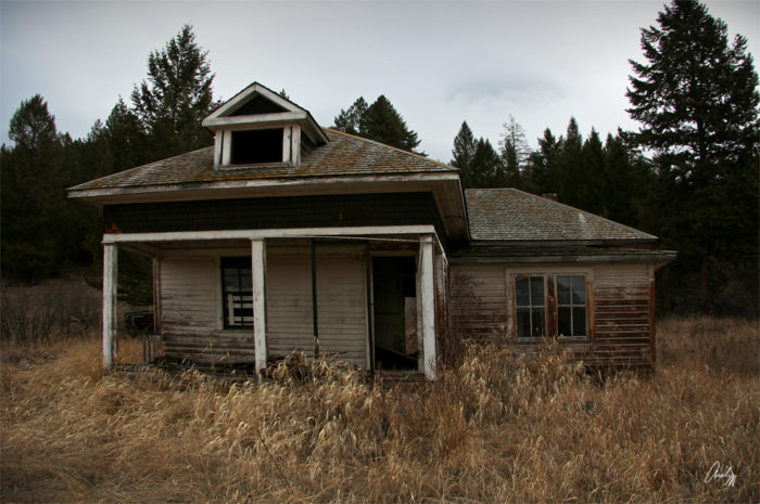 1. This old abandoned house sits right on the border between Montana and Canada.