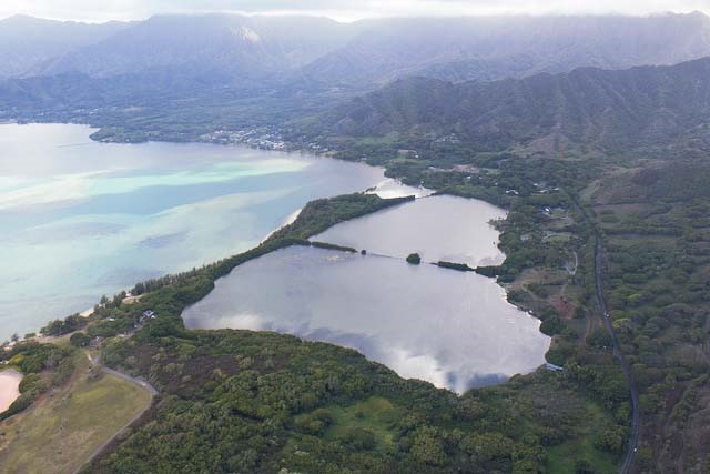 Located in windward Oahu are the Moli'i and 'Apua fishponds, found at the southern end of Kualoa Regional Park, and overlooking Chinaman's Hat.