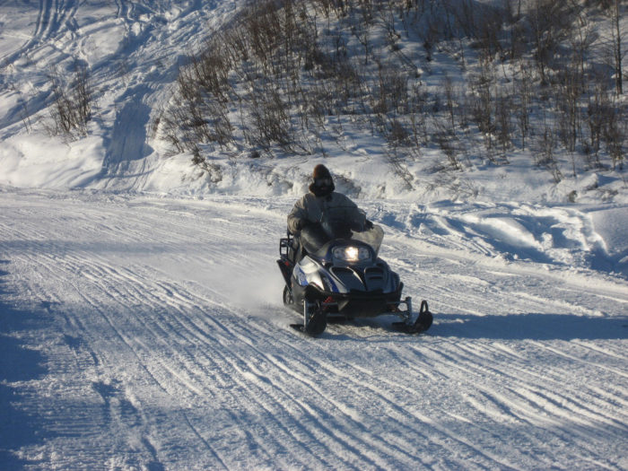 12. Kids riding their snow machines to school.