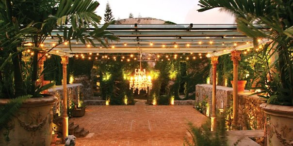 While the mill is beautifully charming during the day, the real magic begins as the sun sets; the moon and the stars sparkle through the open air roof, candles in suspended jars flicker, and an antique chandelier sets the mood.