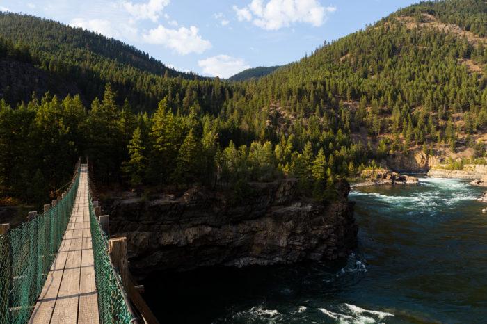16. Walk the swinging bridge to Kootenai Falls.