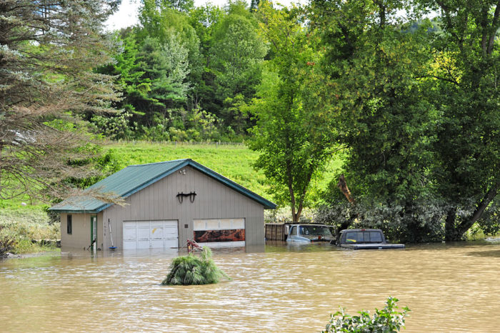 A submerged garage and vehicles just outside Waterbury.