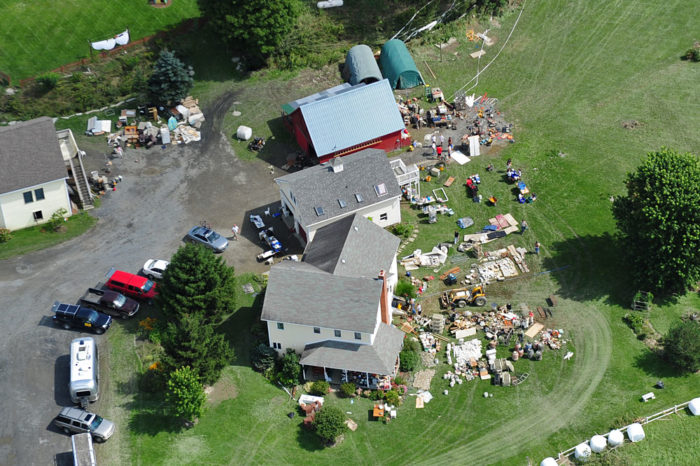 In Waitsfield, Vermont three structures are emptied of wet belongings on Wednesday.