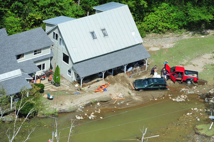 Digging out from the floodwaters in West Bridgewater.