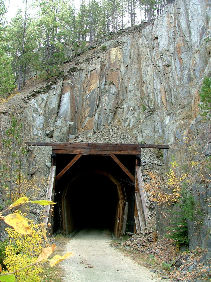 These fascinating tunnels used to allow powerful trains to pass through the Black Hills with minimal grade, resulting in a trail with very few hills as well. It is perfect for biking!
