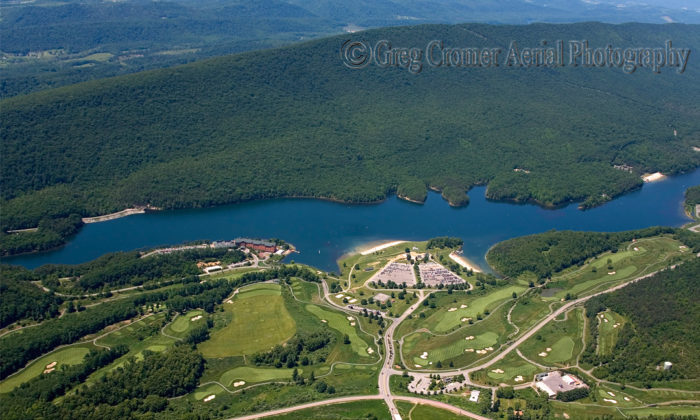 An aerial view reveals Lake Habeeb's sapphire hue, public beaches, and the Rocky Gap resort.