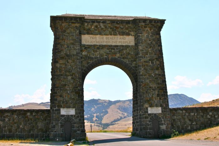 8. Pose at the Roosevelt Arch