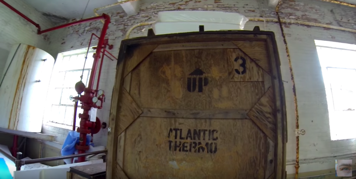 The explorers find a massive crate in a storage area and pry it open.